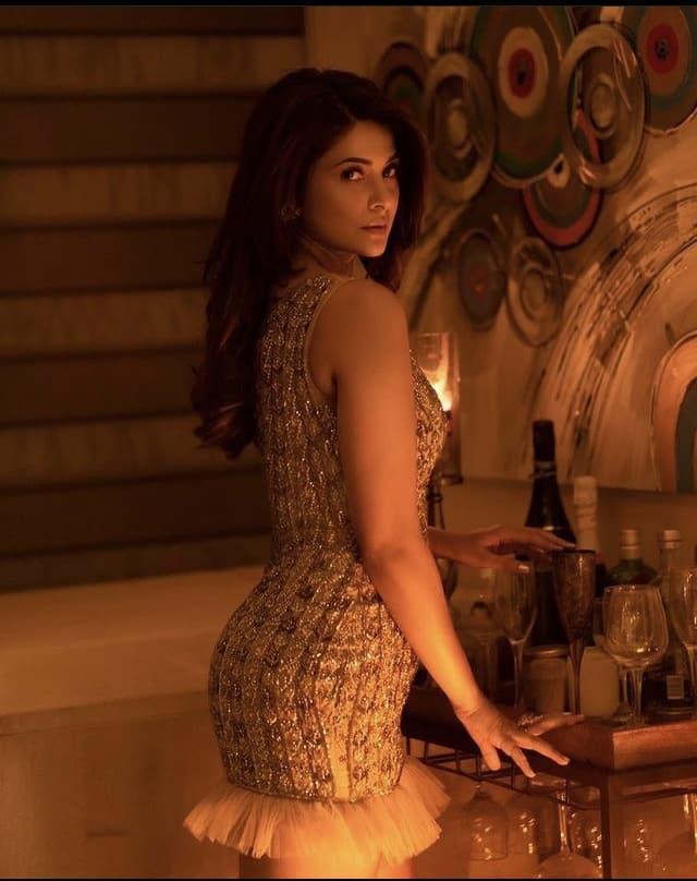 She looks stunning in her shimmery dress