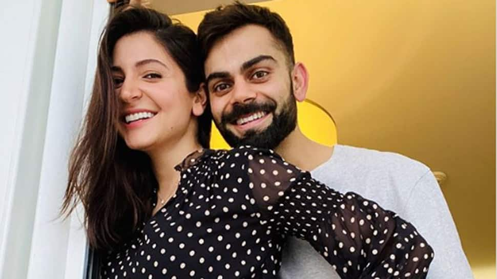 Anushka Sharma holds baby Vamika tightly with cricketer daddy Virat Kohli by her side at airport - See First Pics