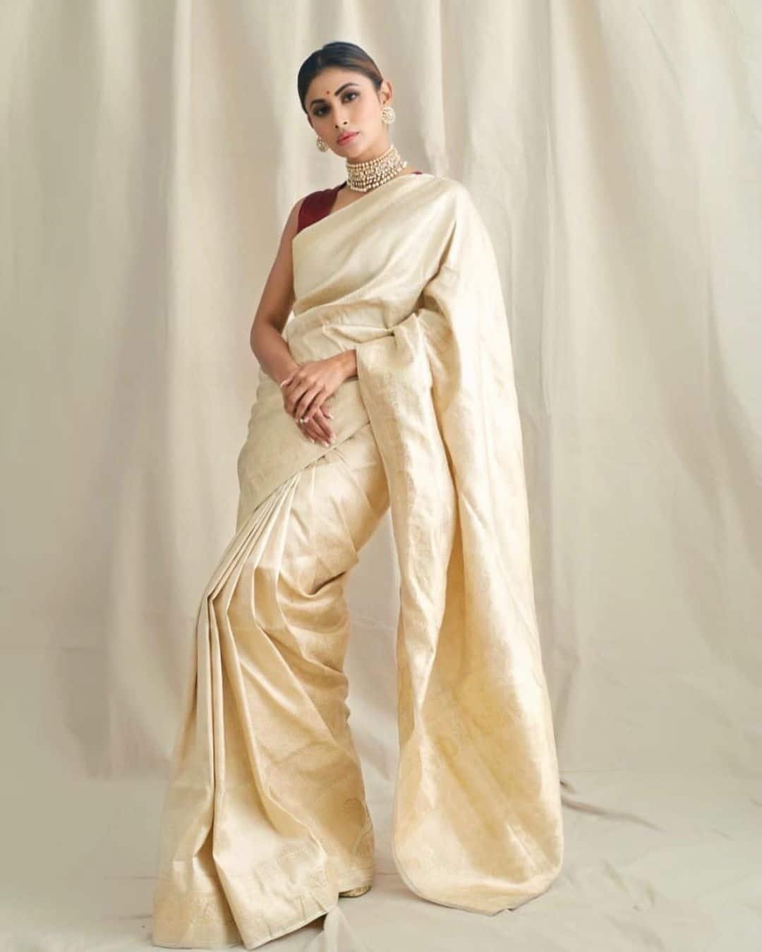 Mouni looks regal in white silk saree