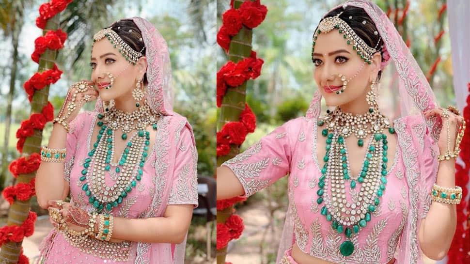 TV amusement   Anupamaa's Kavya aka Madalsa Sharma wore a 10-kg lehenga for wedding country   - See pics