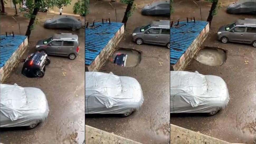 Car drowns in sinkhole after heavy rains lash Mumbai - Watch