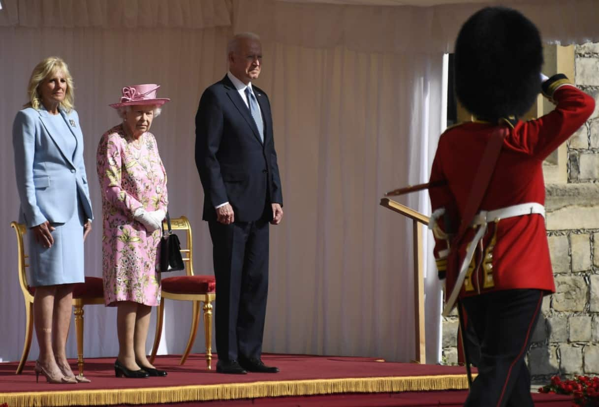 Queen Elizabeth greets Joe Biden and First Lady on the Dias as The First Battalion Grenadier Guards give a Royal Salute
