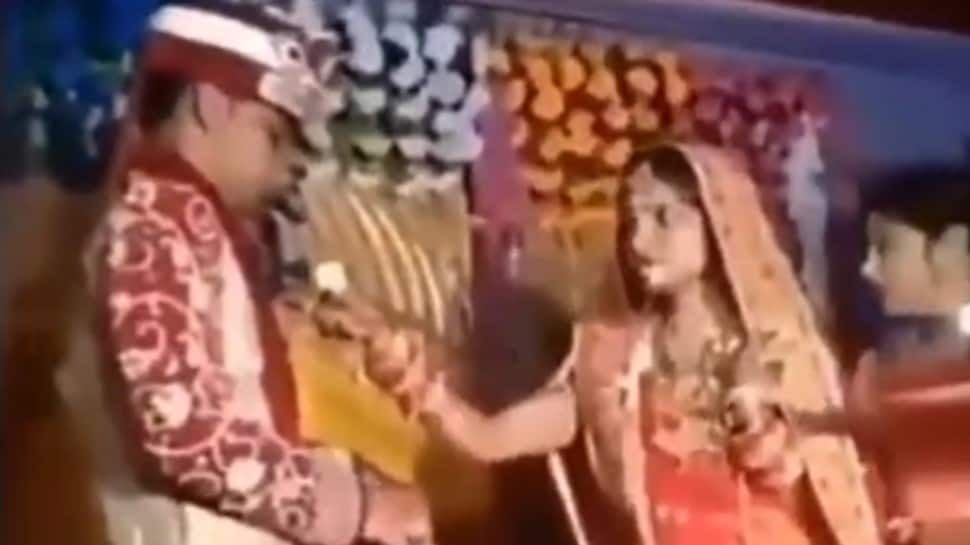 Calm down bhabhi! Bride gets impatient, throws food on groom's face, viral video