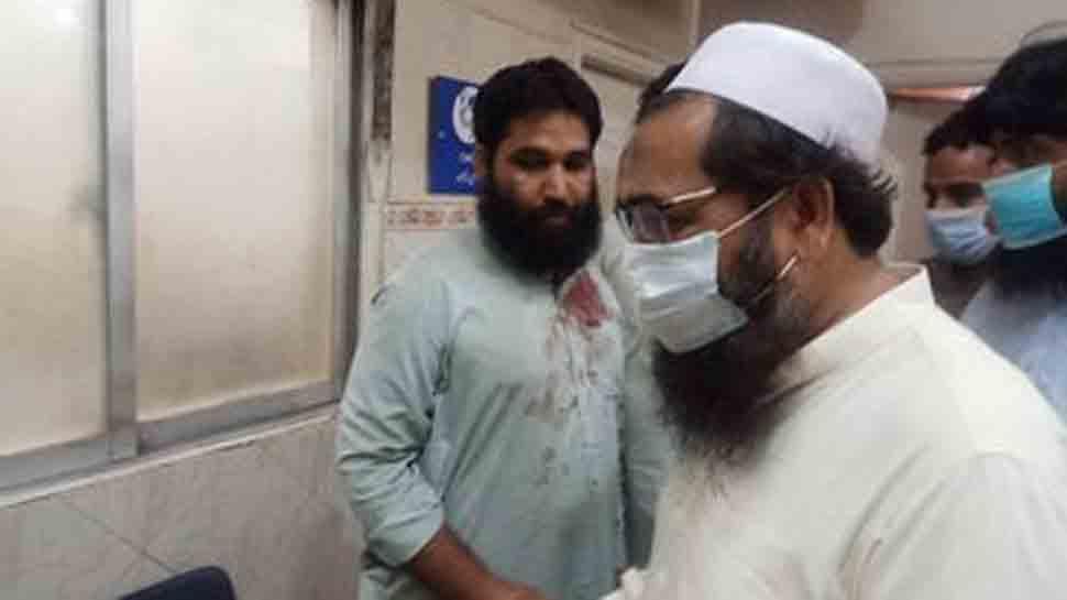 Hafiz Saeed's son Talha meets JuD worker at hospital after Lahore blast