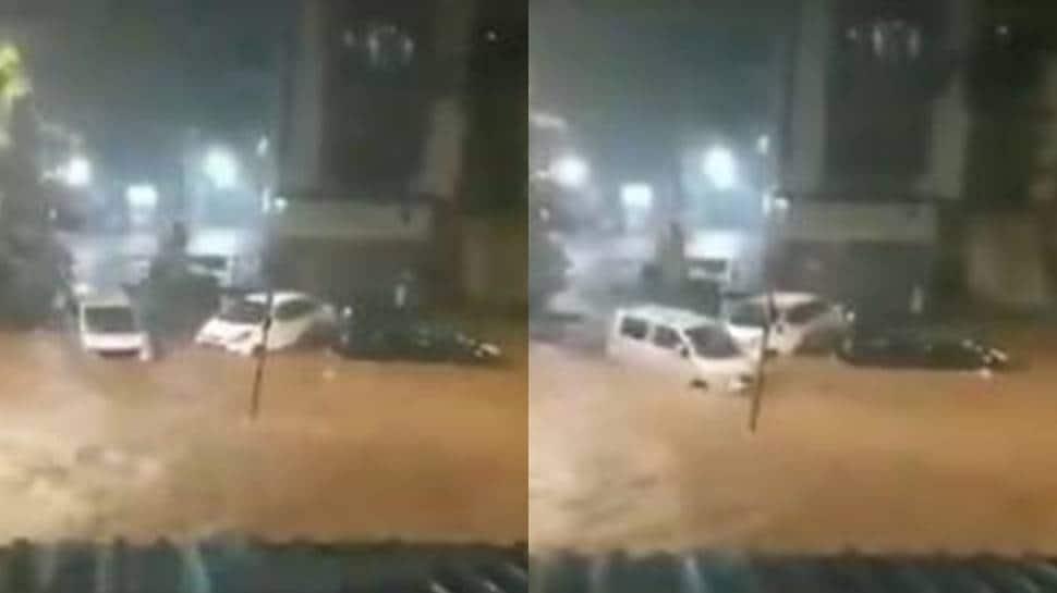Cars swept away in waterlogged streets as heavy rains lash Mumbai