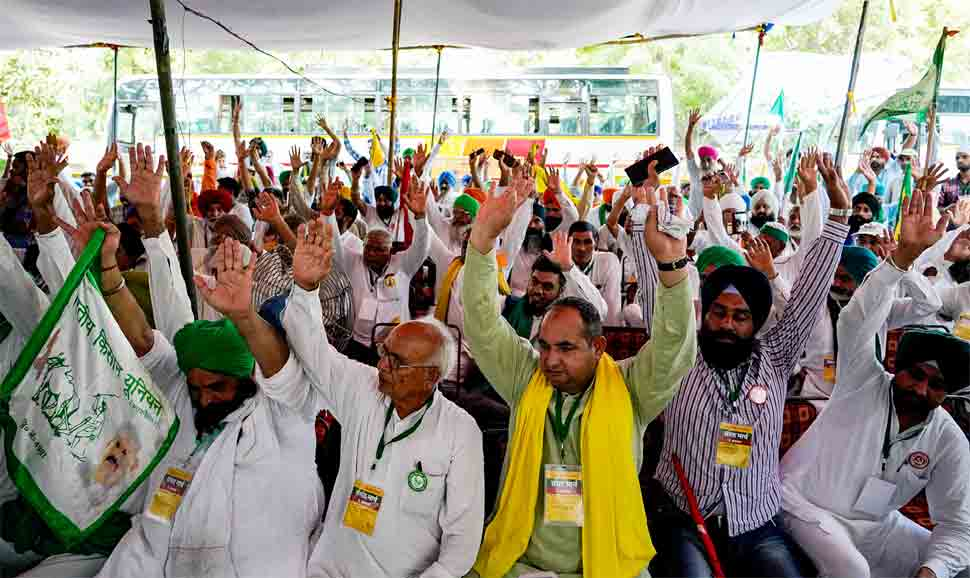 Farmers hold protest in Haryana's Rohtak, push barricades with tractors