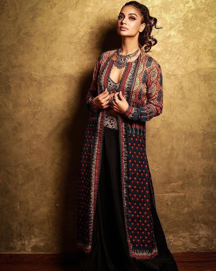 Divya Agarwal wears a chic black indo-western lehenga set
