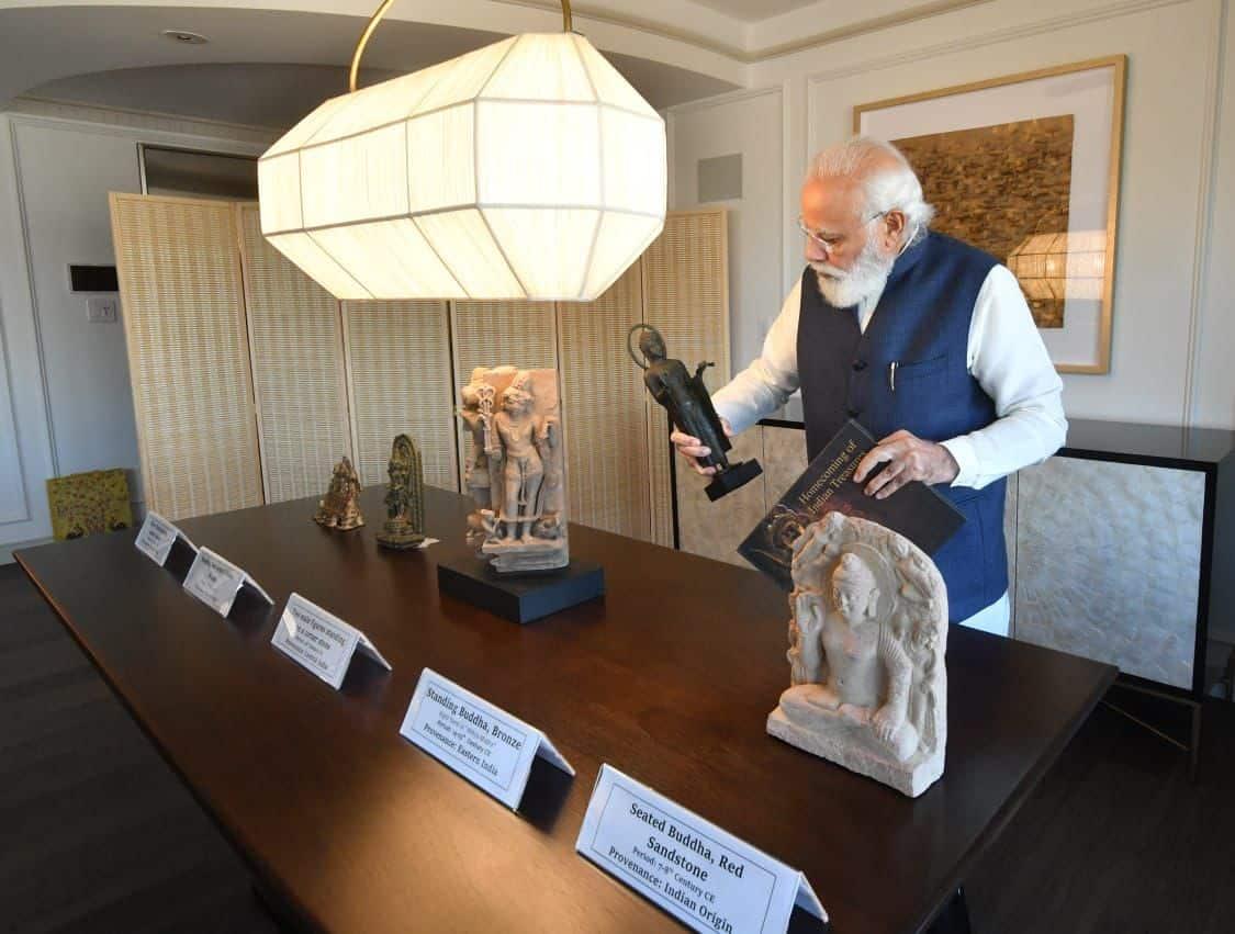 PM Narendra Modi observes artefacts