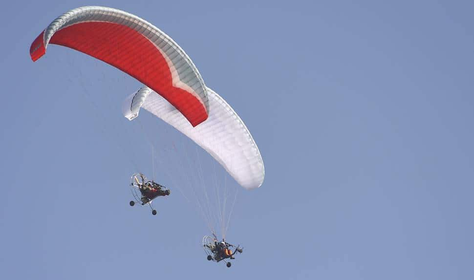 IAF members in parachutes display various formations