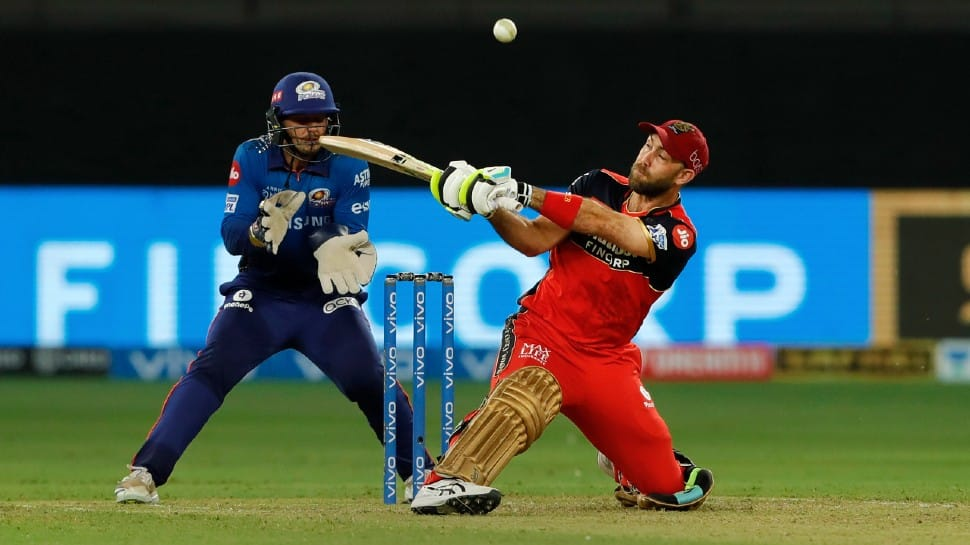 Royal Challengers Bangalore all-rounder Glenn Maxwell goes for a reverse sweep against Mumbai Indians in their IPL 2021 clash in Dubai. (Photo: PTI)