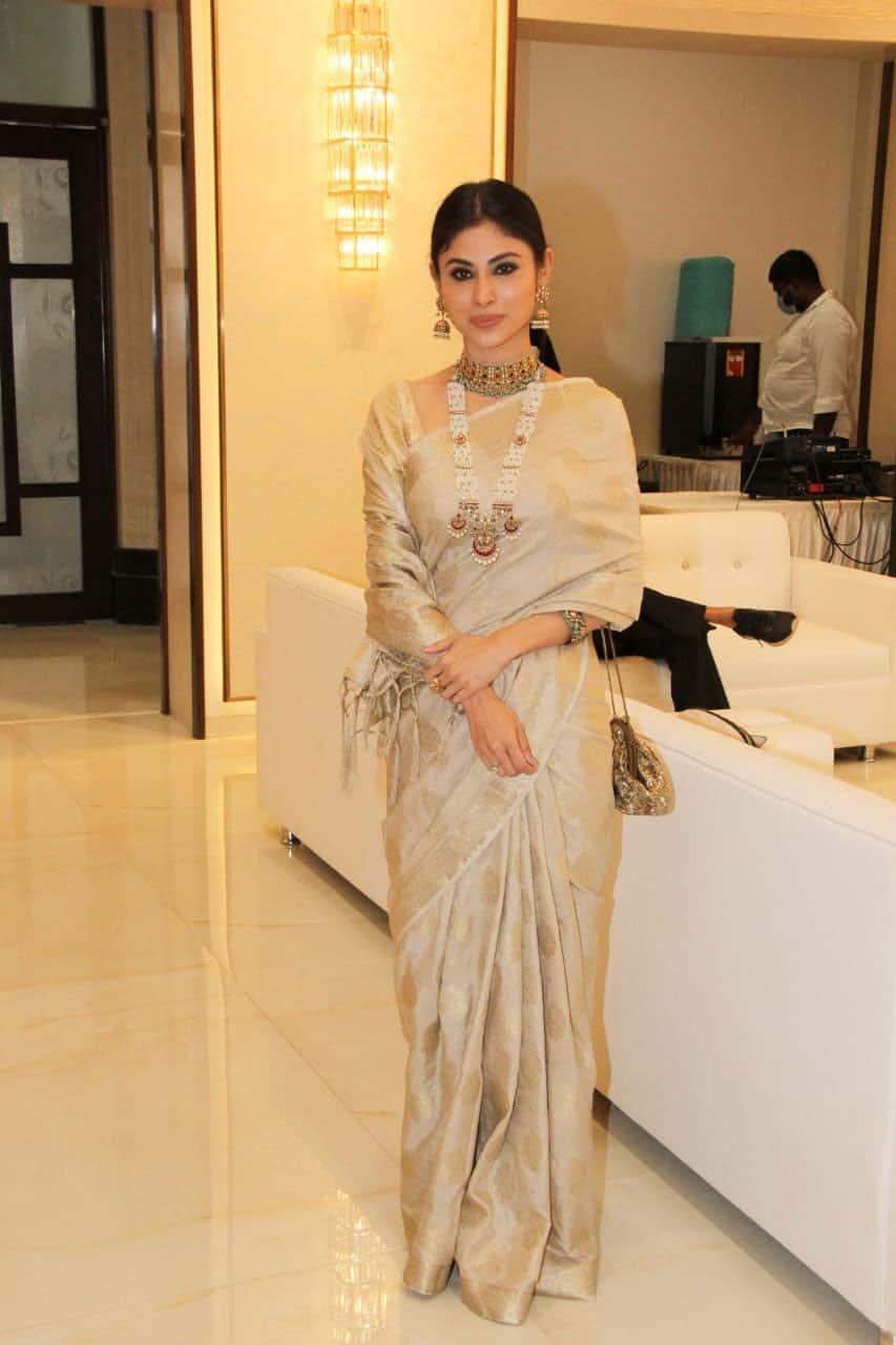 Mouni Roy dons a beige-golden saree
