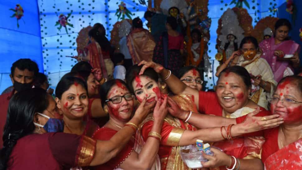 Durga Puja 2021: Reason why married women play Sindoor Khela on Vijayadashami thumbnail