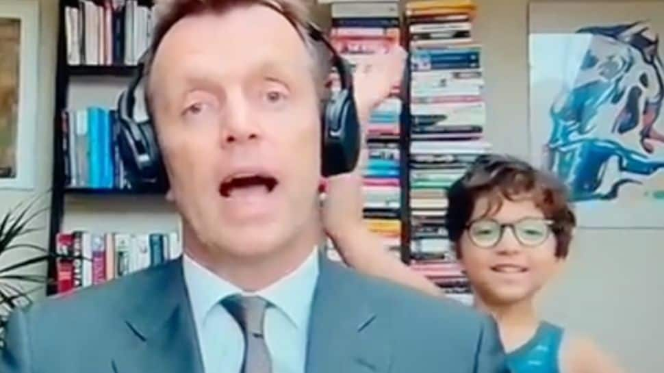 Kid crashes father's live interview on TV, check news host`s reaction in viral video- Watch thumbnail