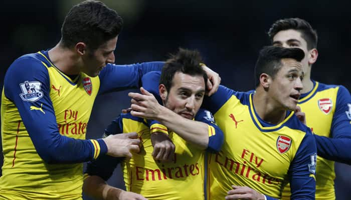 Arsenal, Santi Cazorla, celebrates, teammates, Manchester City, Penalty