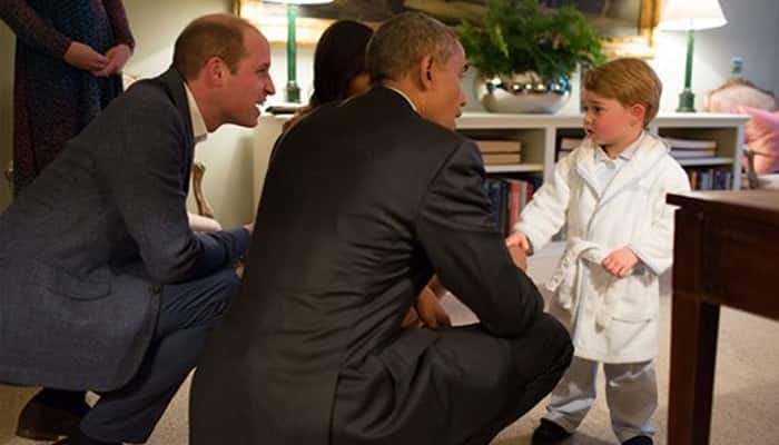 Britain's Prince George meets with US President Barack Obama, centre and first lady Michelle Obama , at Kensington Palace, London.