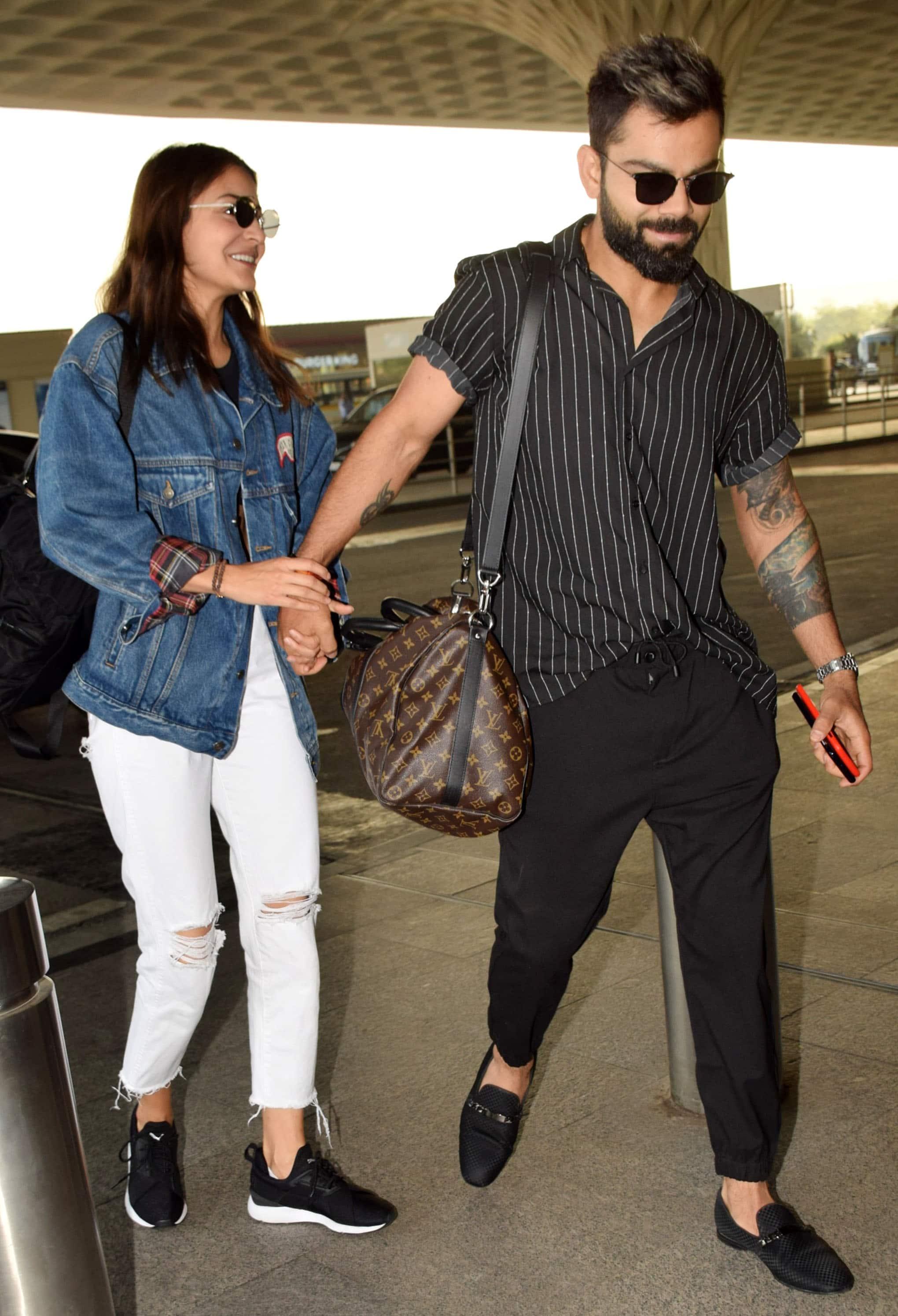 Virat Kohli And Anushka Sharma Slay Airport Fashion In Pics