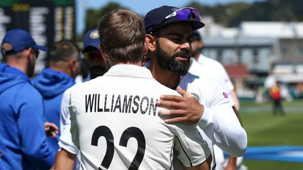 Virat Kohli hugs Kane Williamson