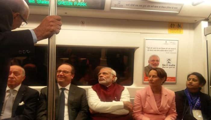 Prime Minister Narendra Modi with French President in Delhi Metro. Photo: Twitter/@PMOIndia