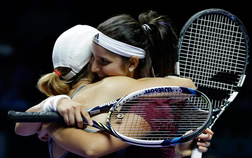 Zimbabwe's Cara Black, left, and India's Sania Mirza embrace as they celebrate after defeating Taiwain's Hsieh Su-Wei and China's Peng Shuai in the doubles final at the WTA tennis finals in Singapore.