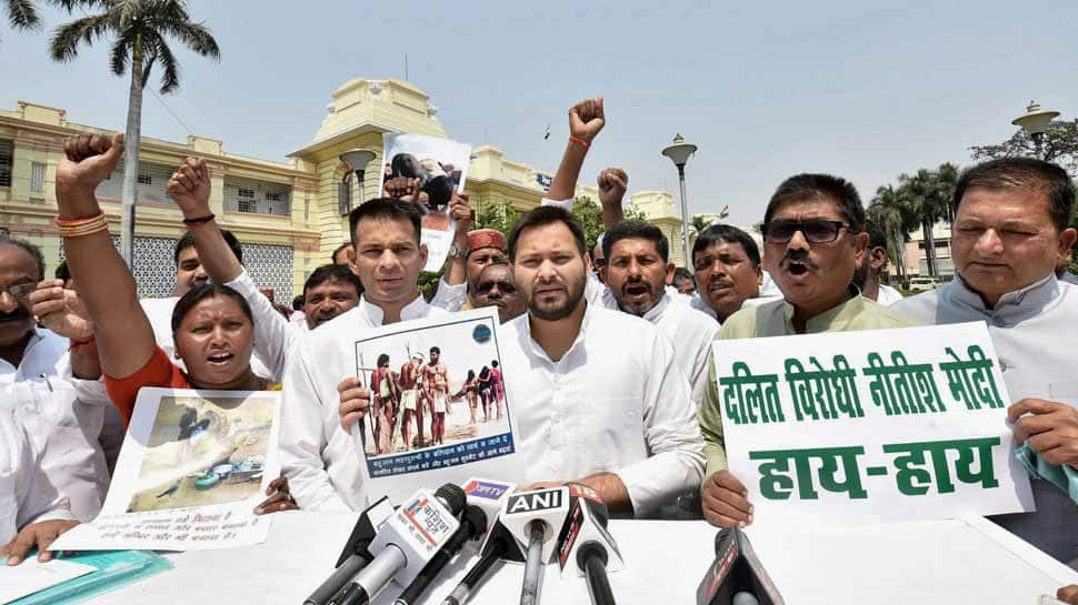 Bharat Bandh: RJD leader of opposition Tejashwi Yadav with MLAs stage a protest against the alleged 'dilution' of the SCs/STs Act by Supreme court, at Bihar Assembly in Patna on Monday (PTI photo)