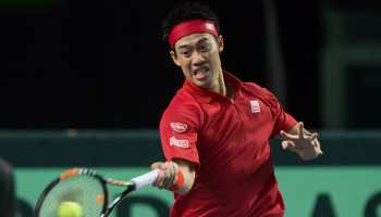 Australian Open: Kei Nishikori reaches second round after Kamil Majchrzak retires