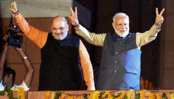 IN NARENDRA MODI WE TRUST, DECLARES INDIA AS BJP-LED NDA ZOOMS PAST 350 LOK SABHA SEATS