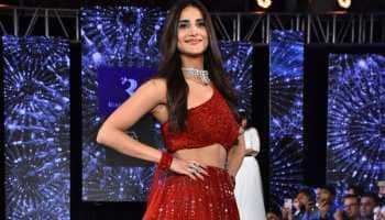 Belle of the ball! Vaani Kapoor walks the ramp in a red lehenga—Pics