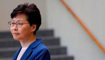 Hong Kong leader Carrie Lam to visit Japan after huge rally, night of violence