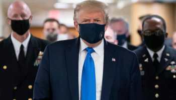In a first, US President Donald Trump wears mask during visit to wounded service members