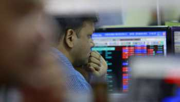 Sensex sinks 470 points on profit booking, metals dip