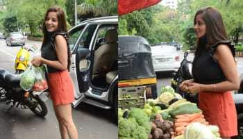 Bhojpuri sensation Monalisa spotted buying veggies in orange shorts and black top, smiles at paps - In Pics