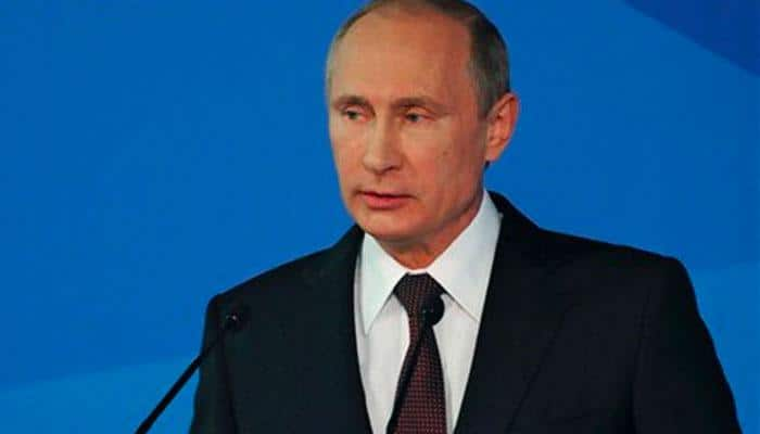 World swimming body stands by decision to honour Vladimir Putin