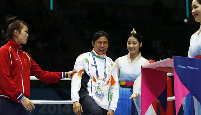 Sarita Devi controversy: Boxing India to issue showcause notice to coach, husband