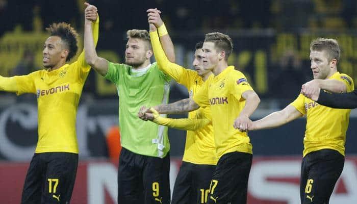 Nervy Borussia Dortmund earn draw to secure top spot