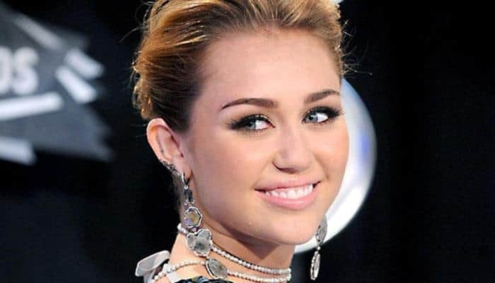 Miley Cyrus posts topless pic on Instagram in support of 'Free the Nipple' campaign
