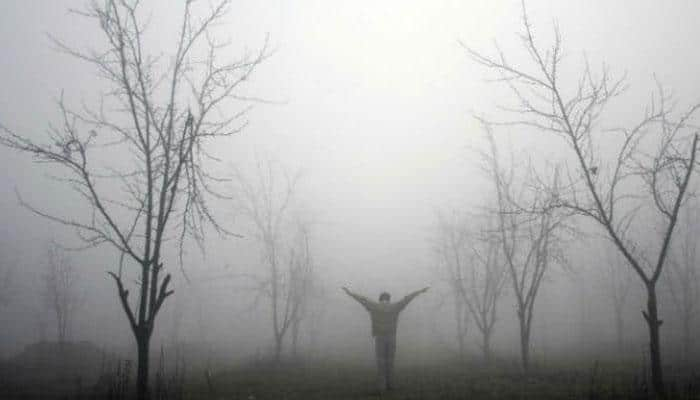 North shivers under chilly spell; fog hits rail, air traffic