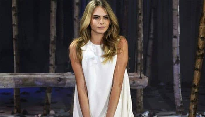 Cara Delevingne poses topless for jewellery ad
