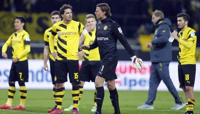 Borussia Dortmund lose to 10-man Augsburg as crisis deepens