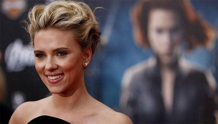 Scarlett Johansson says John Travolta's Oscars 'welcome' kiss wasn't 'creepy'