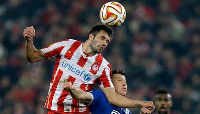 Olympiakos chief Evangelos Marinakis fines players for poor displays
