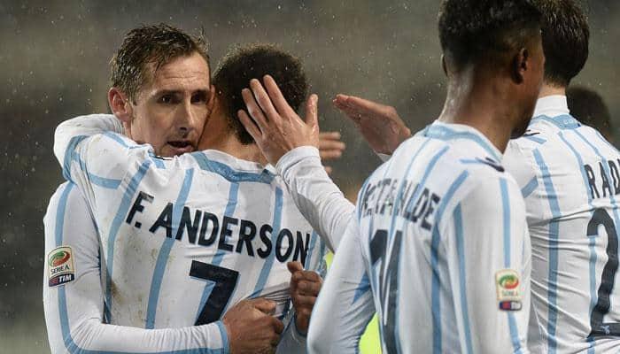 Miroslav Klose on target as Lazio keep tabs on Roma