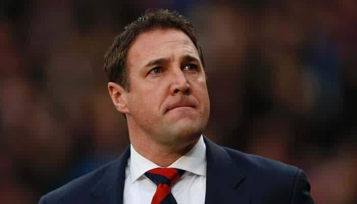 Wigan Athletic fire manager Malky Mackay