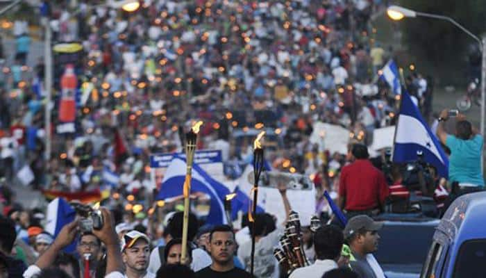 Thousands of Hondurans protest president in latest march