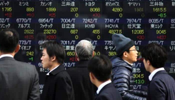 Asian shares slide halts but weak commodity outlook weighs