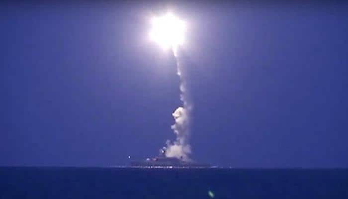 Russian warships fire cruise missiles as Moscow backs Syrian offensive