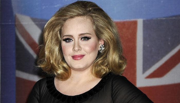 Adele gets emotional as 'Hello' debuts on radio