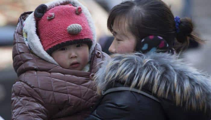China scraps approvals for first, second children
