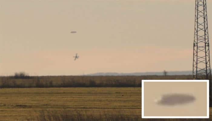 Are those military aircraft trailing a UFO?