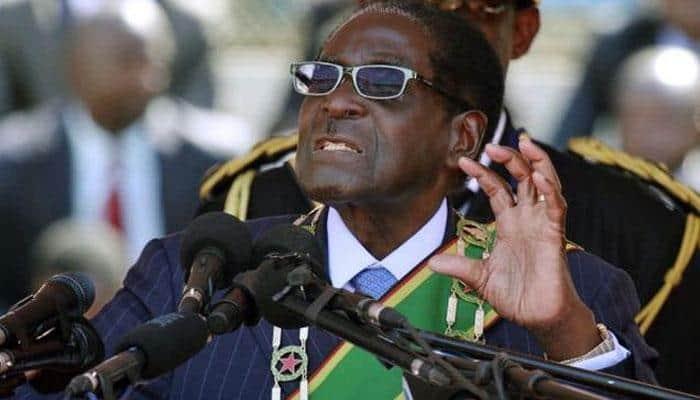 After Pranab Mukherjee, Zimbabwe President Robert Mugabe pulls out of Sri Sri's event
