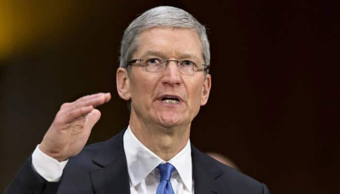 Apple's Tim Cook visits Beijing after China woes, Didi deal